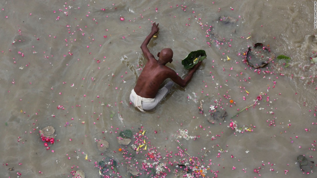 <strong>Phaphamau, India:</strong> In September, a Hindu devotee performs Pind Daan rituals for the soul of ancestors in the river Ganges at Phaphamau in Allahabad, India.