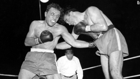 Jake LaMotta, left, pounds Marcel Cerdan in the third round of their 1949 world middleweight title bout in Detroit, Mich. LaMotta won the title by a knockout in the tenth round.