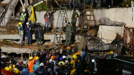Rescue crews rush to save survivors trapped under the collapsed school.