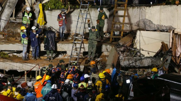 Rescuers in Mexico City work to save a child trapped inside the Enrique Rebsamen elementary school on September 20. Rescue workers said they believed they'd made contact with a girl trapped in the rubble at the school. But by the next afternoon, navy official Angel Enrique Sarmiento said all the school's children had been accounted for and there was no student in the rubble. He apologized for the confusion.