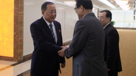 North Korean Foreign Minister Ri Yong Ho, left, shakes hands with North Korean Vice Foreign Minister Pak Myong Guk as he leaves the Pyongyang Airport on Tuesday.