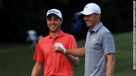 HONOLULU, HI - JANUARY 12:  Justin Thomas of the United States is congratulated by Jordan Spieth of the United States after chipping in on the tenth hole during the first round of the Sony Open In Hawaii at Waialae Country Club on January 12, 2017 in Honolulu, Hawaii.  (Photo by Sam Greenwood/Getty Images)