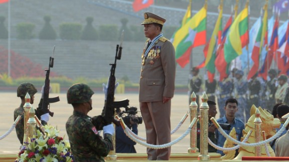 Days before Aung San Suu Kyi's government took office in March 2016, honor guards raised their bayonet mounted rifles in salute to Sen. General Min Aung Hlaing, commander-in-chief of the Myanmar armed forces, during a ceremony to mark the 71st Armed Forces Day.