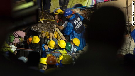 Emergency workers during rescue efforts Thursday at the Enrique Rebsamen school in Mexico City.