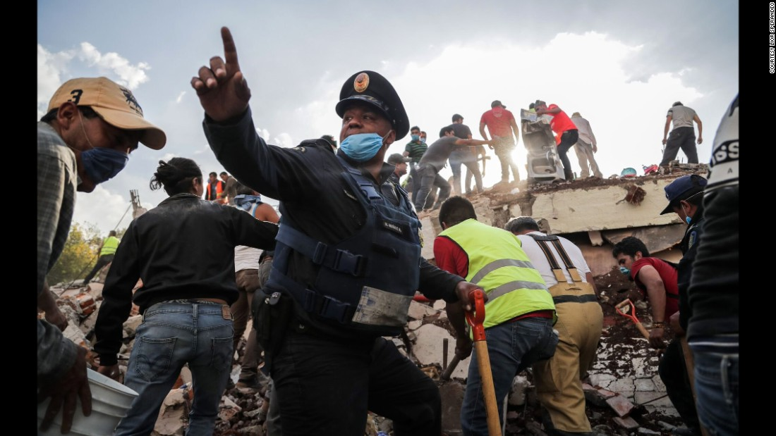 "Rescue efforts take place at the site of a collapsed building in Mexico City on Tuesday, September 19. A magnitude 7.1 earthquake <a href=""http://www.cnn.com/interactive/2017/09/world/mexico-quake-cnnphotos/"" target=""_blank"">rocked central Mexico,</a> leveling many buildings and killing at least 250 people."