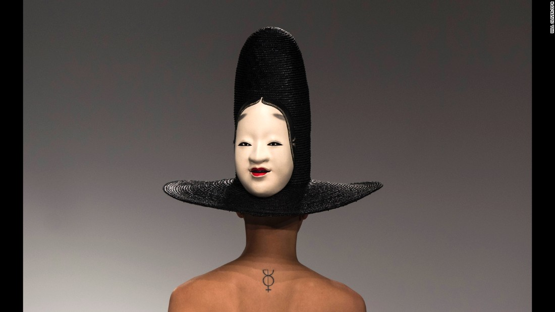 A model wears a hat designed by the A.W.A.K.E. label during London Fashion Week on Tuesday, September 19.