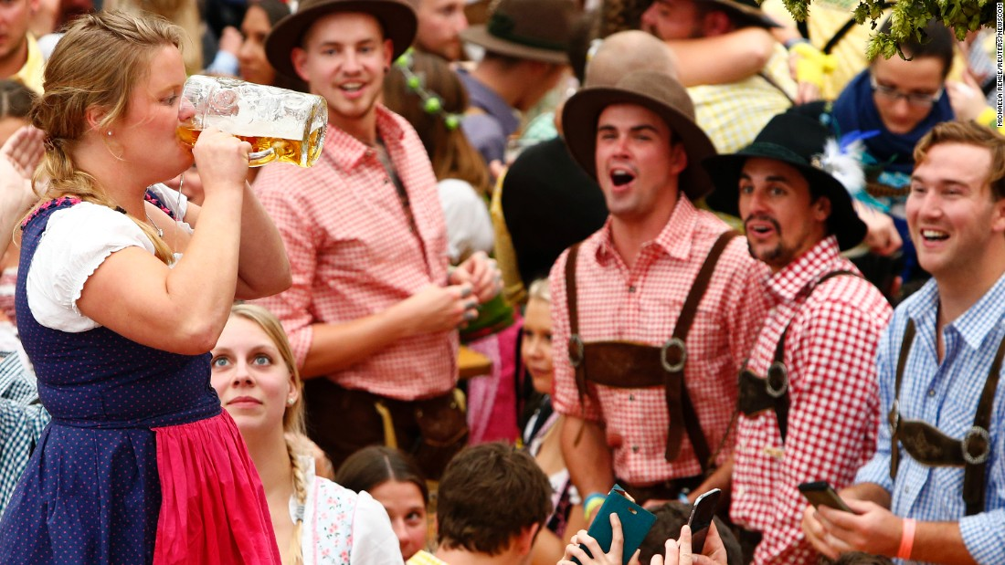 "A visitor drinks beer Saturday, September 16, as Oktoberfest began in Munich, Germany. <a href=""http://www.cnn.com/2016/09/21/world/gallery/tbt-oktoberfest/index.html"" target=""_blank"">See historic photos of the world's largest beer festival</a>"