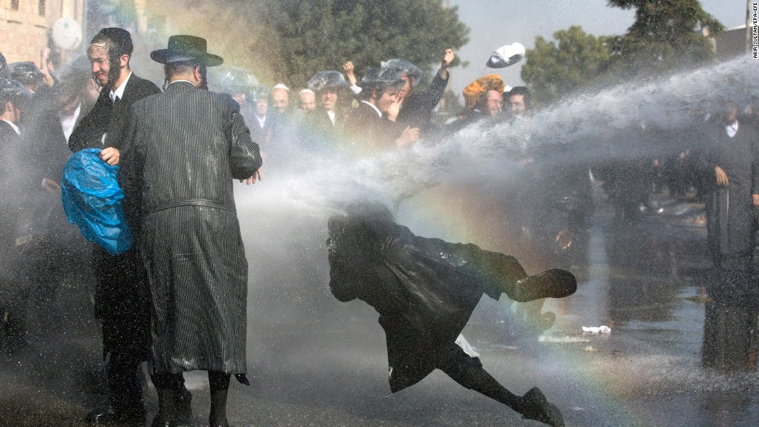 Israeli police use a water cannon to disperse ultra-Orthodox Jews who were holding an anti-draft protest on Sunday, September 17. Earlier this month, the Israeli Supreme Court rejected a bill that would have exempted some ultra-Orthodox Jews from mandatory military service.