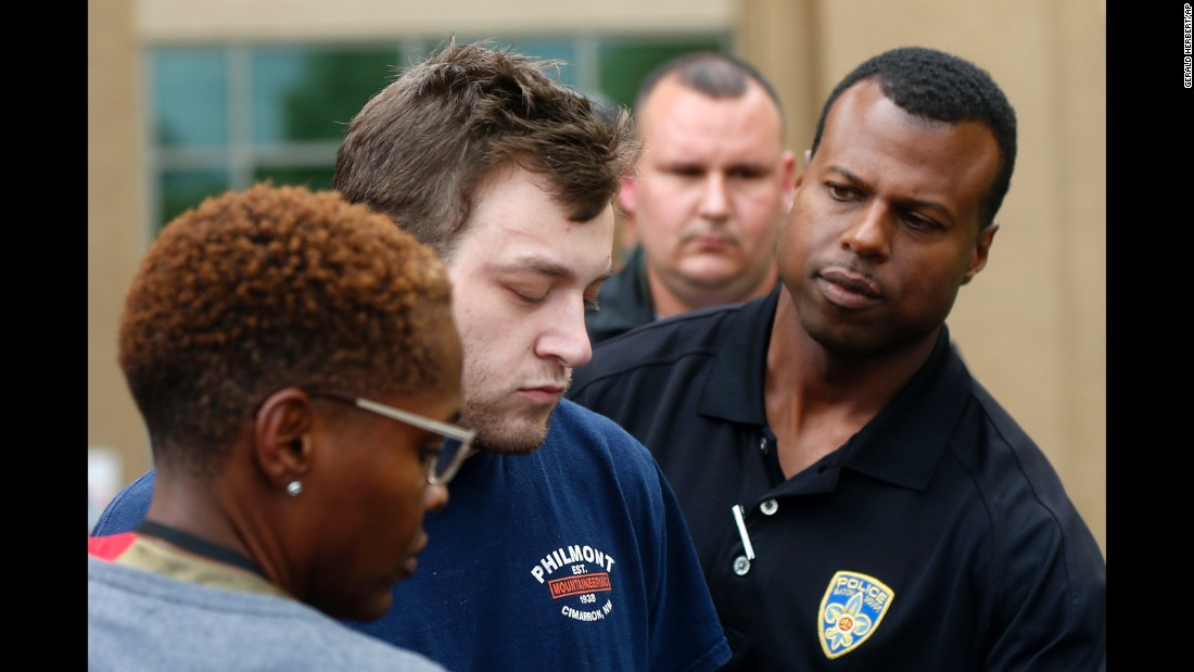 "Kenneth James Gleason is escorted by police to a waiting police car in Baton Rouge, Louisiana, on Tuesday, September 19. Gleason, 23, <a href=""http://www.cnn.com/2017/09/19/us/baton-rouge-shootings/index.html"" target=""_blank"">was charged with murder </a>after police matched his DNA to shell casings found at the scene of a pair of homicides, authorities said."