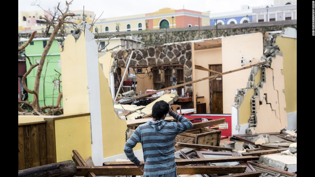 "Homes are damaged in La Perla, a neighborhood in San Juan, Puerto Rico, a day after Hurricane Maria made landfall on Wednesday, September 20. Hurricane Maria is the strongest storm to make landfall in Puerto Rico in 85 years. It came ashore with sustained winds of 155 mph, <a href=""http://www.cnn.com/interactive/2017/09/world/hurricane-maria-puerto-rico-cnnphotos/index.html"" target=""_blank"">knocking out power to the entire island.</a> Trees were uprooted, homes were destroyed, and there was also widespread flooding."
