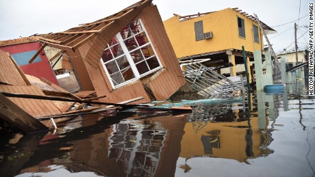 A destroyed house lays flooded in Catano town, in Juana Matos, Puerto Rico, on September 21, 2017.
