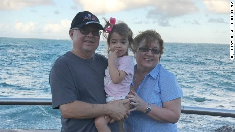 Gretchen Lopez is searching for her family in Puerto Rico. Pictured are her parents, with Gretchen's daughter.