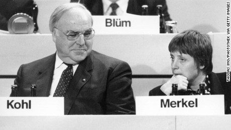 A younger Angela Merkel and then German Chancellor Helmut Kohl at a party convention in Dresden in 1991.