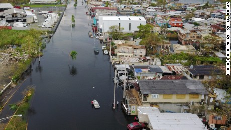 An aerial view shows the flooded neighborhood of Juana Matos in the aftermath of Hurricane Maria in Catano, Puerto Rico, on Friday, September 22.