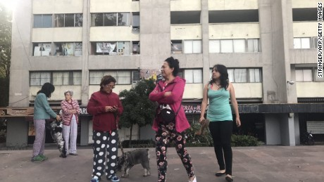 People evacuate buildings in Mexico City's Tlatelolco area after a seismic alert sounded Saturday.
