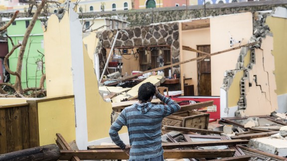 A resident of the La Perla neighborhood in San Juan, Puerto Rico, surveys the damage.