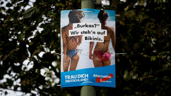 """A poster from the far-right Alternative for Germany on September 21 in Berlin, Germany, that reads """"Burkas? We prefer bikinis""""."""