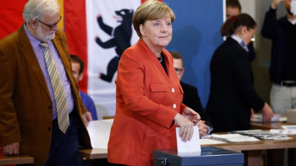 German Chancellor Angela Merkel casts her vote at a polling station in Berlin during general elections on September 24.