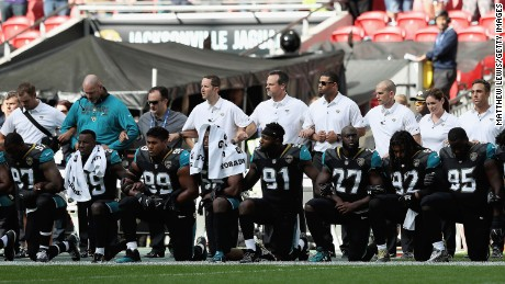 Jacksonville Jaguar players show their protest during the National Anthem during the NFL International Series match between Baltimore Ravens and Jacksonville Jaguars at Wembley Stadium on September 24 in London, England.