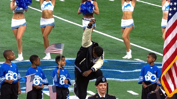 Rico LaVelle closed out the national anthem on one knee Sunday.