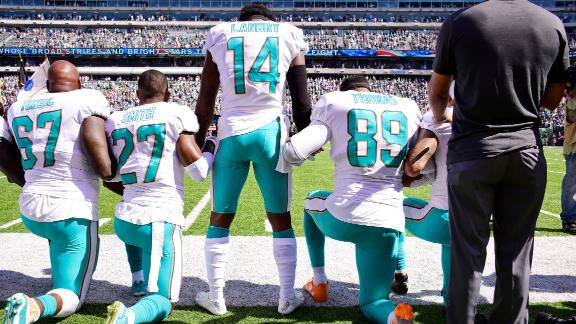 Miami Dolphins players, from left, Laremy Tunsil, Maurice Smith, Jarvis Landry and Julius Thomas take a knee during the National Anthem prior to a game against the New York Jets at MetLife Stadium in East Rutherford, New Jersey.