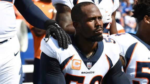 Denver Broncos Von Miller, left, and Brandon Marshall  take a knee during the anthem before their game.