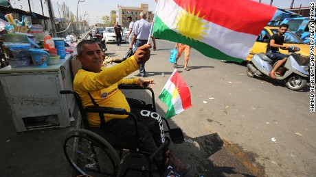 A man waves a Kurdish flag in central Kirkuk on the eve of the independence referendum.