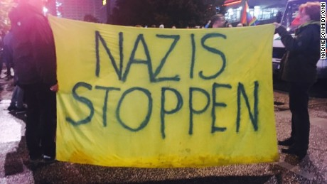 "Large banner outside AFD election party rally reading ""stop Nazis"""