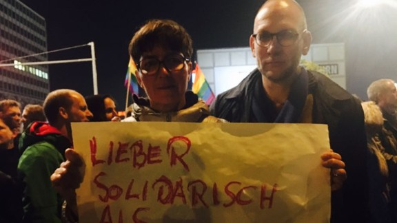 Couple Elgin and Friedhelm from Berlin rushed out to attend the protest after watching the results at home.