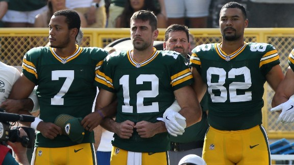GREEN BAY, WI - SEPTEMBER 24:  Members of the Green Bay Packers stand with arms locked as a sign of unity during the national anthem prior to their game against the Cincinnati Bengals at Lambeau Field on September 24, 2017 in Green Bay, Wisconsin.  (Photo by Dylan Buell/Getty Images)