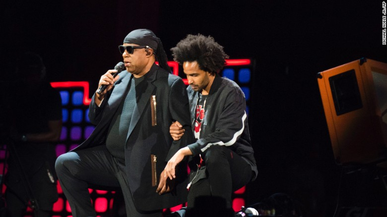 Stevie Wonder takes both knees 'for America'