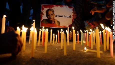 Indian activists take part in a protest rally against the killing of Indian journalist Gauri Lankesh at the India Gate memorial in New Delhi on September 6, 2017.