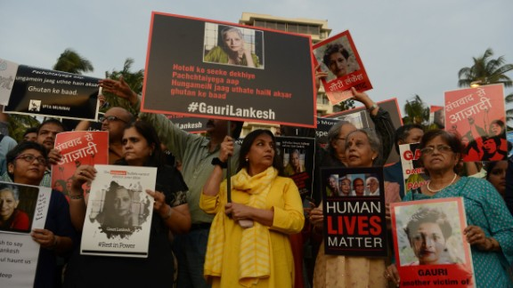Indian protesters hold placards in a rally condemning the killing of journalist Gauri Lankesh, in Mumbai on September 6, 2017.