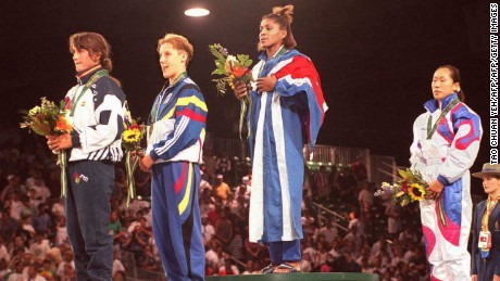 A triumphant Driulis Gonzales stands atop the podium at the Atlanta 1996 Olympics, alongside Spain's Isabel Fernandez, Belgium's Marisabel Lomba and South Korean Jung Sun-Yong.