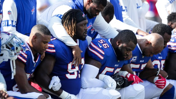 ORCHARD PARK, NY - SEPTEMBER 24:  Buffalo Bills players kneel during the American National anthem before an NFL game against the Denver Broncos on September 24, 2017 at New Era Field in Orchard Park, New York.  (Photo by Brett Carlsen/Getty Images)