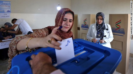 An Iraqi Kurdish woman casts her vote in Irbil on Monday.