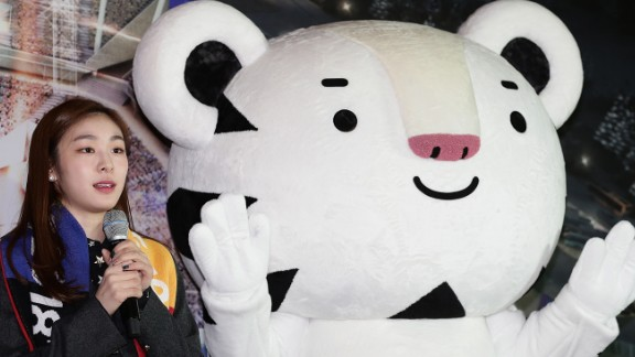 Former Olympic figure skater Yuna Kim introduces Winter Olympics mascot Soohorang the white tiger.