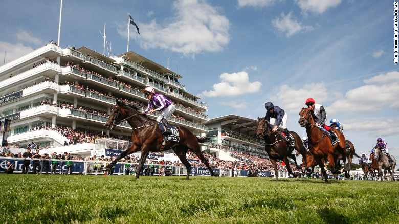 EPSOM, ENGLAND - JUNE 03: Padraig Beggy riding Wings Of Eagles (L, pink cap) win The Investec Derby from Cliffs Of Moher (C, dark blue) on Investec Derby Day at Epsom Racecourse on June 3, 2017 in Epsom, England. (Photo by Alan Crowhurst/Getty Images)