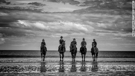 LAYTOWN, IRELAND - SEPTEMBER 05: (EDITORS NOTE: This image was processed using digital filters) Racehorses take a stroll in the Irish Sea before racing at Laytown racecourse on September 5, 2017 in Laytown, Ireland. Laytown racecourse is a horse racing venue run on the beach in County Meath, Ireland. Laytown is unique in the Irish racing calendar as it is the only race event run on a beach under the Rules of Racing. (Photo by Alan Crowhurst/Getty Images)