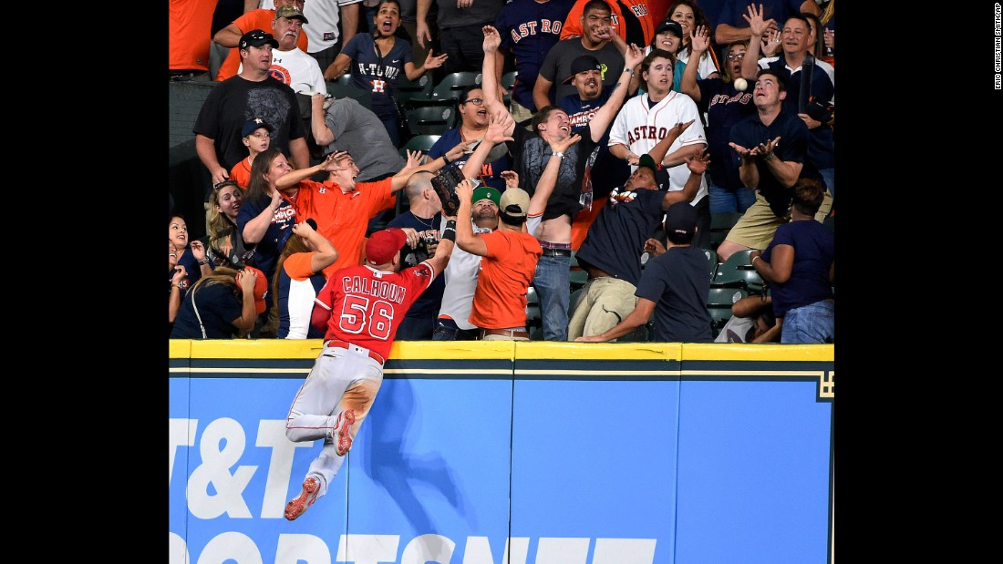 Los Angeles Angels right fielder Kole Calhoun watches fans catch a George Springer home run during a Major League Baseball game in Houston on Sunday, September 24.