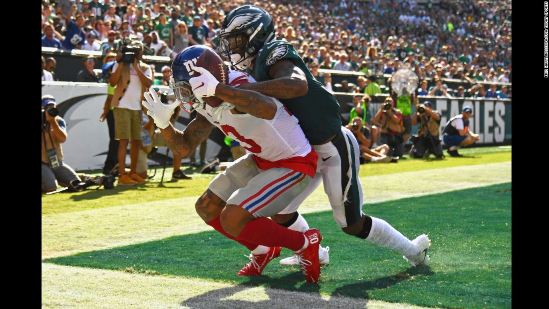 Odell Beckham Jr. catches a fourth-quarter touchdown pass during an NFL game in Philadelphia on Sunday, September 24. Beckham had two touchdowns in the game, but Philadelphia won 27-24 when Jake Elliott kicked a 61-yard field goal as time expired.