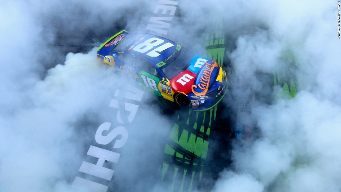 NASCAR driver Kyle Busch celebrates with a burnout after winning the Cup Series race in Loudon, New Hampshire, on Sunday, September 24. It was the second race of the playoffs.