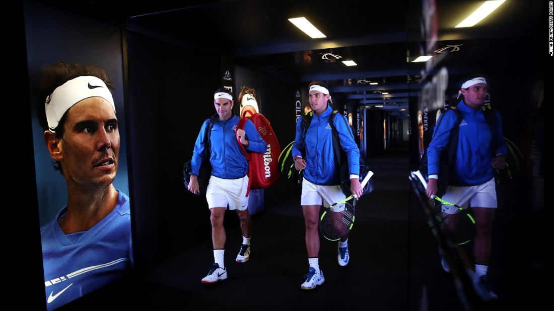 Longtime tennis rivals Roger Federer, left, and Rafael Nadal enter the arena to play a doubles match together in Prague, Czech Republic, on Saturday, September 23. They won their match for Team Europe, which went on to defeat Team World in the inaugural Laver Cup.