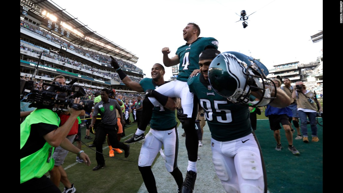 "Philadelphia kicker Jake Elliott is carried off the field after <a href=""http://bleacherreport.com/articles/2734908-jake-elliott-drills-61-yarder-in-last-second-as-eagles-stun-eli-manning-giants"" target=""_blank"">his 61-yard field goal</a> defeated the New York Giants on Sunday, September 24. It was the longest kick in team history."