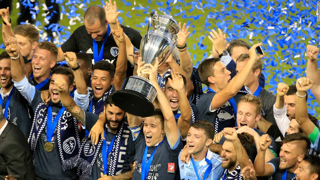 Sporting Kansas City captain Matt Besler hoists the US Open Cup after the Major League Soccer team won the tournament final on Wednesday, September 20. Sporting has won three Open Cups since 2012.