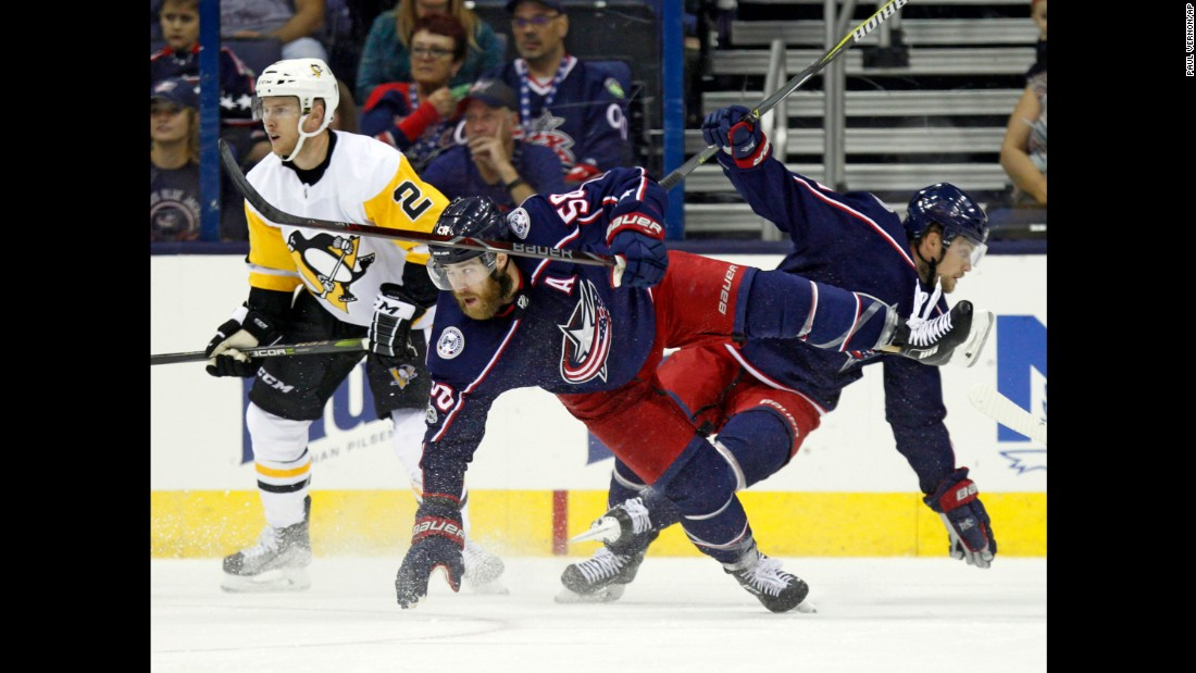 Columbus defenseman David Savard, center, collides with teammate John Mitchell during an NHL preseason game on Friday, September 22. The regular season begins on October 4.