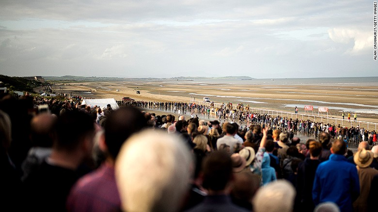 More than 5000 regular visitors watch the horse racing on the temporary track at Laytown.