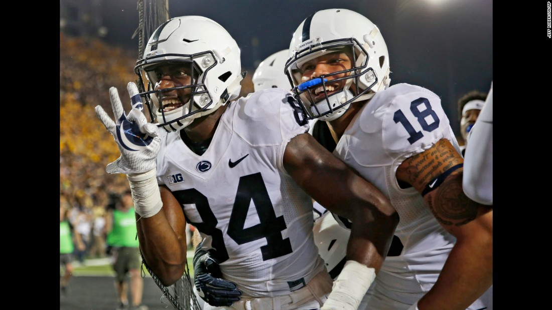 "Penn State wide receiver Juwan Johnson, left, is congratulated by teammate Jonathan Holland after catching the game-winning touchdown pass at Iowa on Saturday, September 23. The touchdown came on <a href=""http://bleacherreport.com/articles/2734807-penn-state-beats-iowa-on-final-play-behind-saquon-barkleys-huge-performance"" target=""_blank"">the final play of the game.</a>"