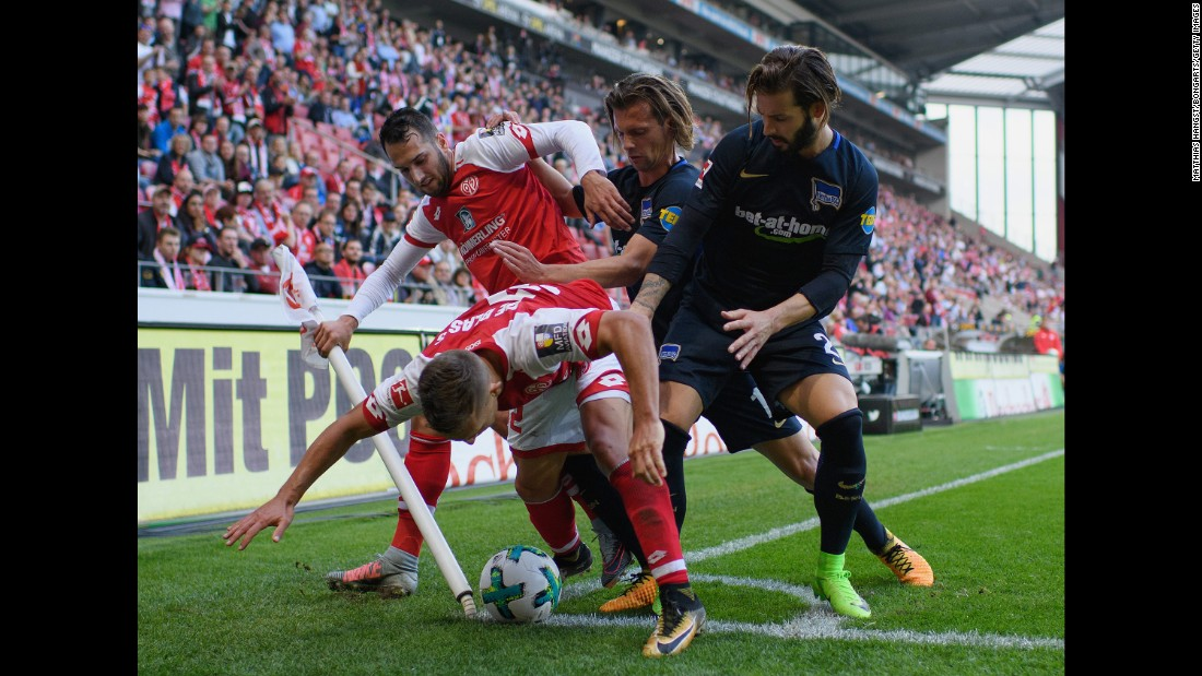 Mainz midfielder Pablo de Blasis, bottom left, shields the ball from Hertha Berlin players during a German league match on Saturday, September 23.