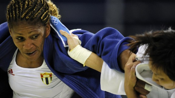 Cuba's Driulis Gonzalez (L) and Chinese Taipei Chin-Fang Wang compete during their women's -63kg judo match of the 2008 Beijing Olympic Games on August 12, 2008 in Beijing.     AFP PHOTO / OLIVIER MORIN (Photo credit should read OLIVIER MORIN/AFP/Getty Images)